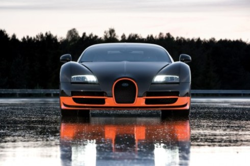 bugatti veyron super sport on wet race track.