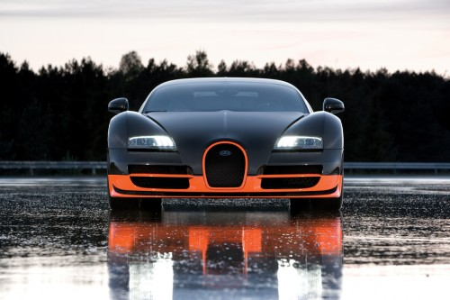 bugatti veyron super sport on wet race track.